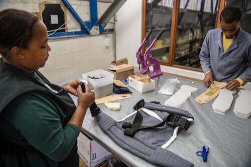 Cutting fabric at Ubuntu Baba.