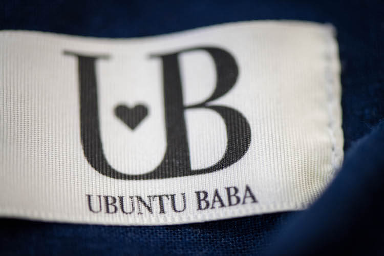 Ubuntu Baba logo stitched onto their baby carrier.
