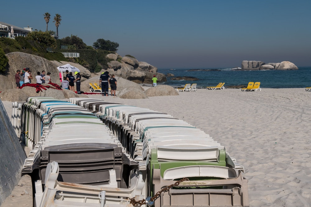 Chairs laid out on Cape Town beach by JK Vending.