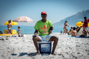 An image of a vendor sitting on a collar on Cape Town's beaches.