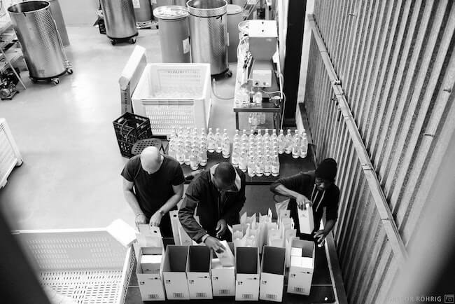 Packing Gin into boxes at Hope on Hopkins.