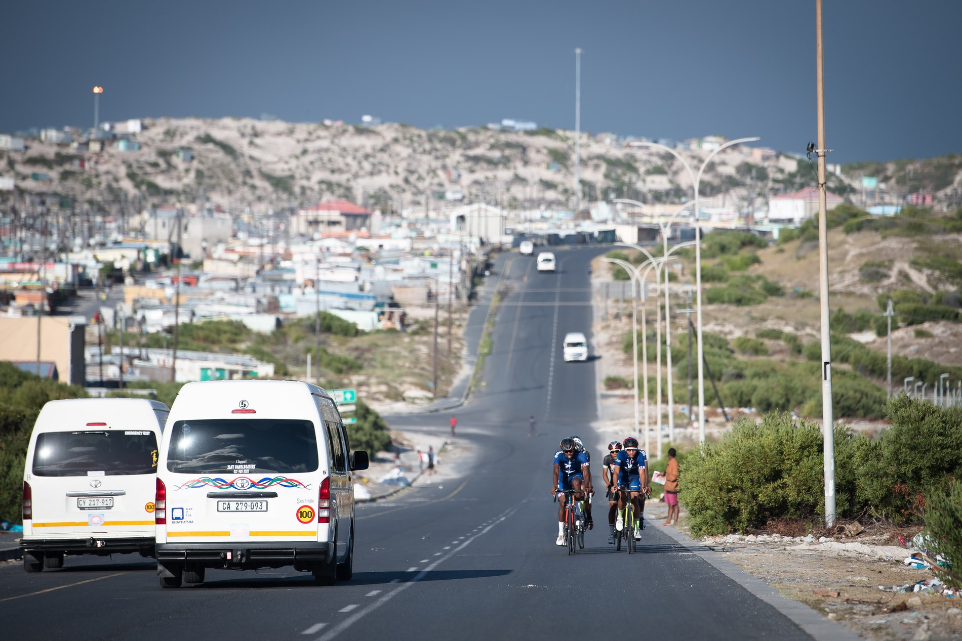 Velokhaya cyclists passing taxis on their cycle.