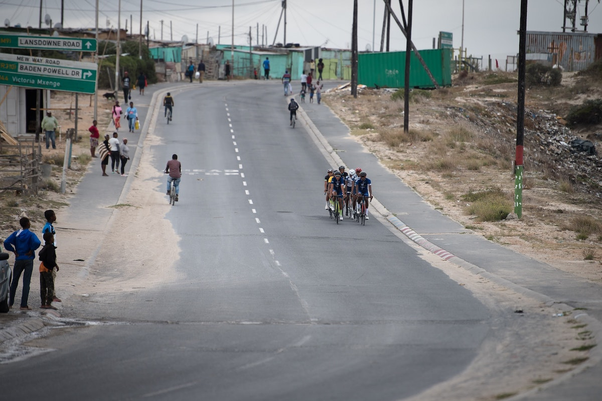 Cyclists from Velokhaya Cycling Academy cycling through Khayelitsha.