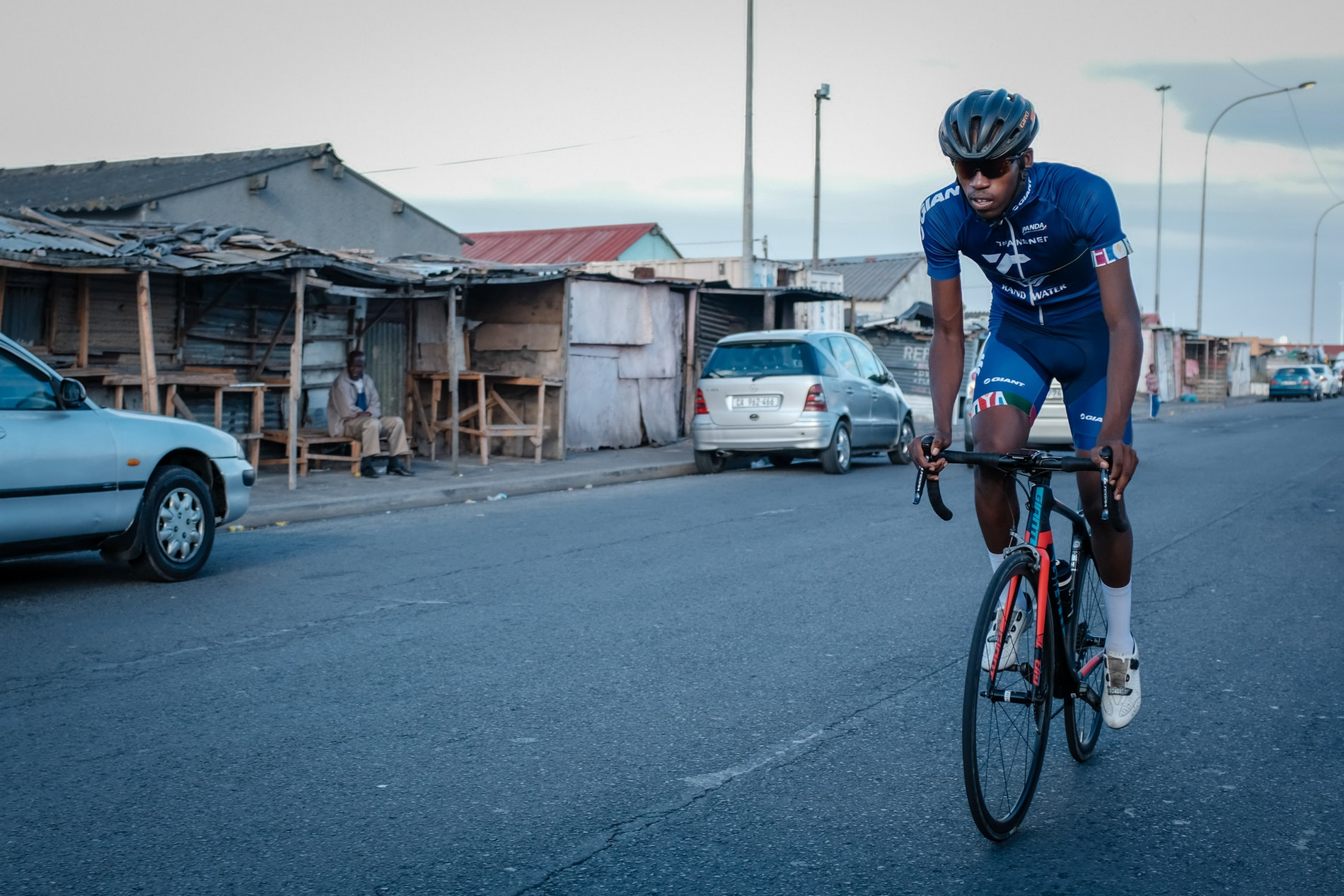 Loyiso Fulu of Velokhaya cycling through Khayelitsha.