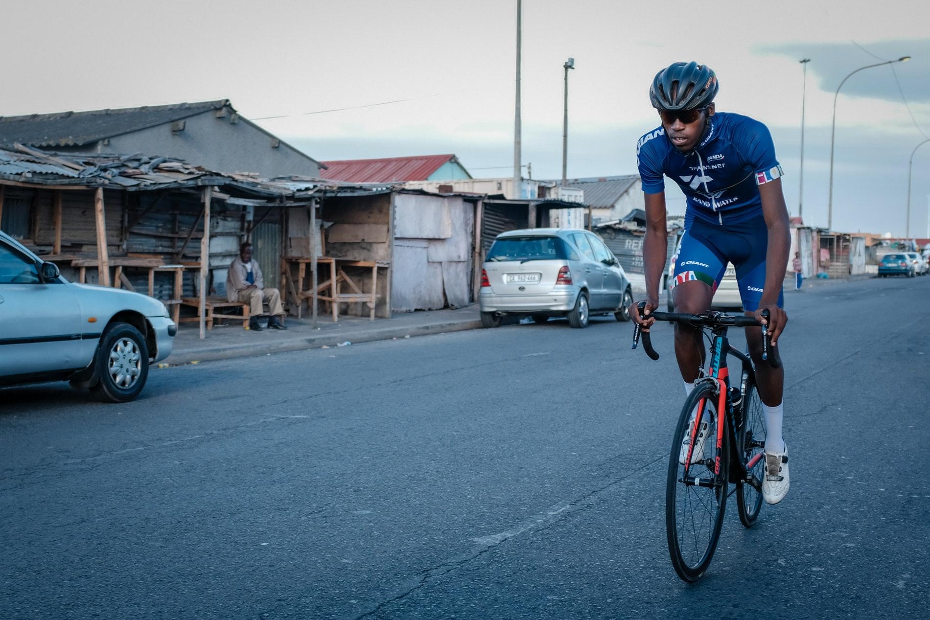 Loyiso Fulu of Velokhaya cycling through Khayelitsha.