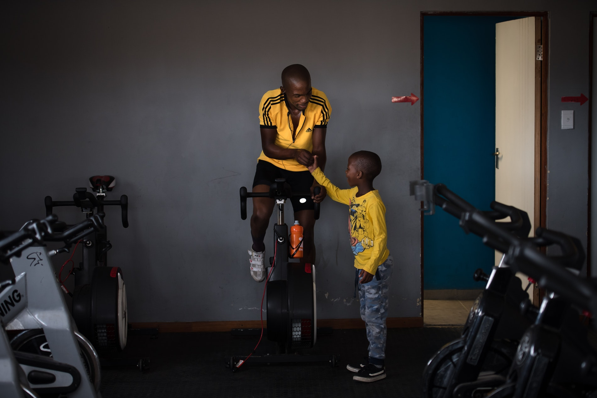 An older and younger rider at Velokhaya Cycling Academy.