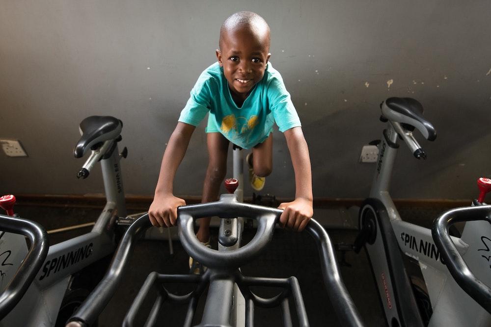 Child riding the Watt bike.