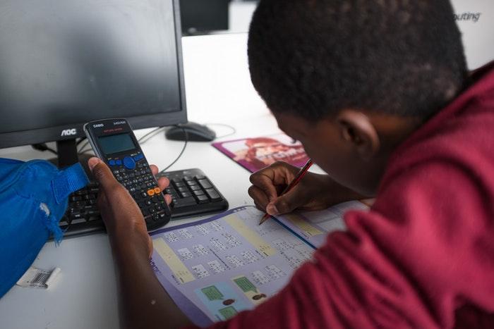 A student doing their homework at Velokhaya.