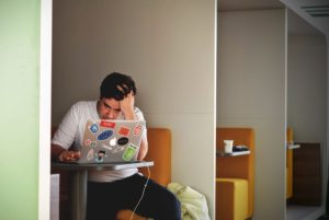 An image of a stressed man in an article on the effect your business may have on your health.