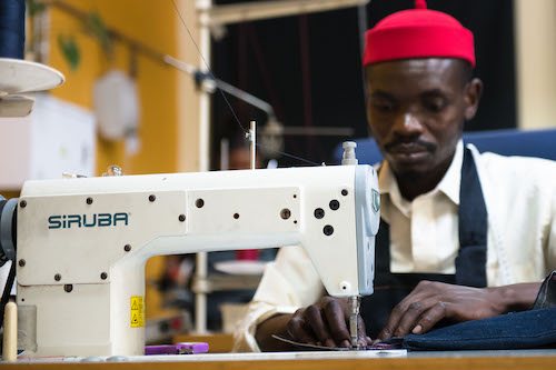 Achmed the tailor working at the sewing machine.