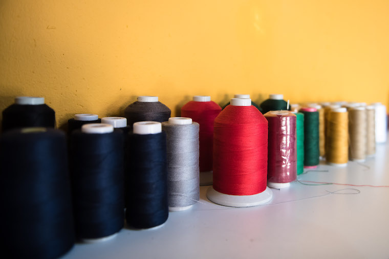 Cotton thread used for stitching the jeans.