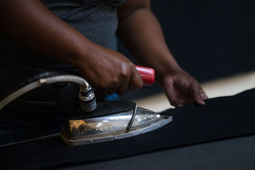 Ironing the jeans made at Tshepo the Jean Maker.
