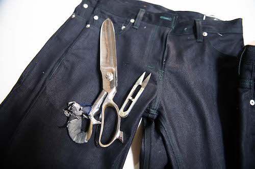 Scissors and a pair of jeans.