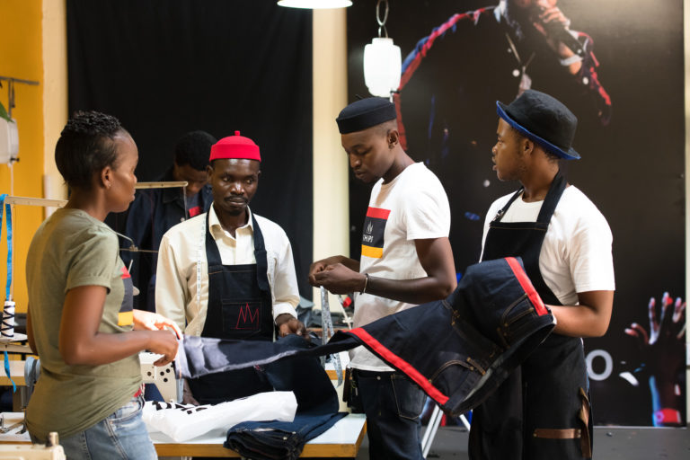 Tshepo the Jean Maker and his employees.