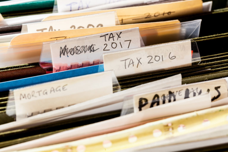 An image of a folder with filed tax returns.