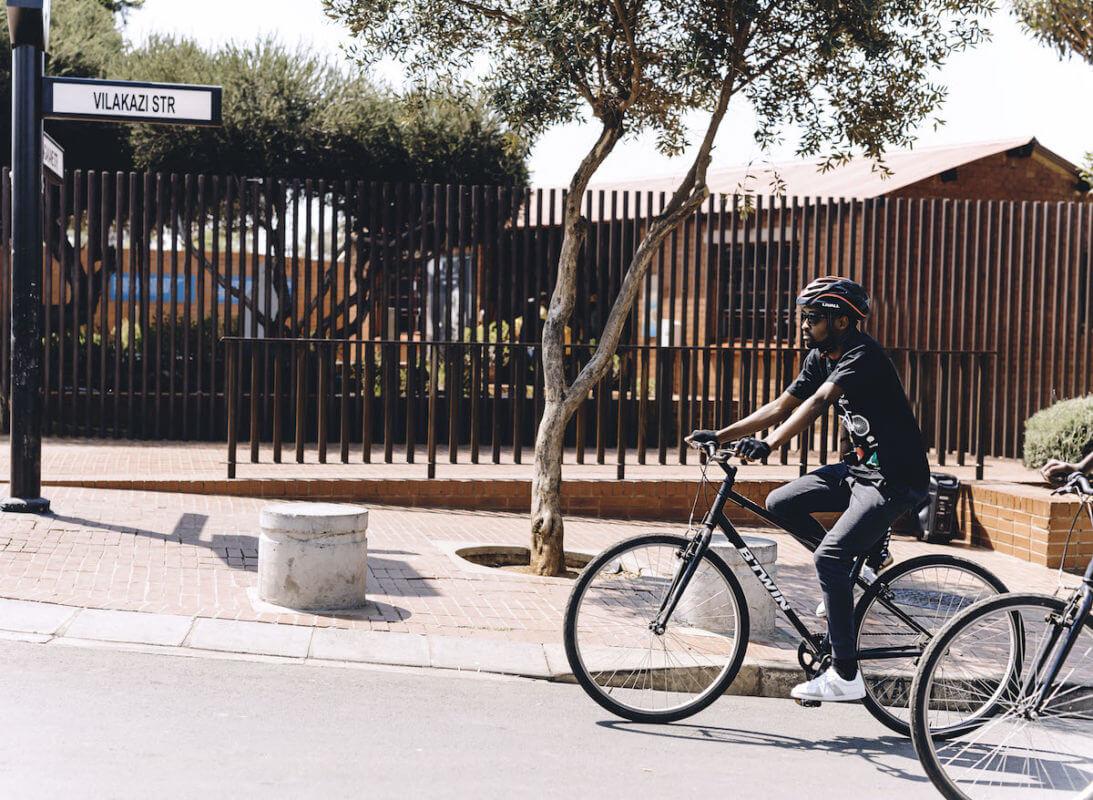 Mpumelelo Mtintso, founder of Book Ibhoni riding past Vilakazi Street.