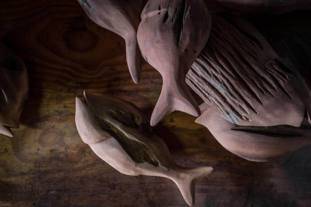Making fish out of wood.